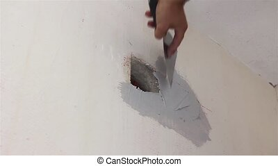 Plaster application - Man Applying Plaster on a Dry Wall...