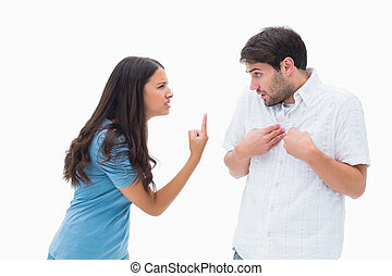 Angry brunette shouting at boyfriend on white background