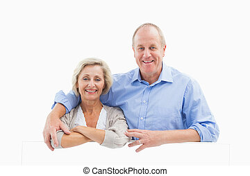 Mature couple smiling at camera