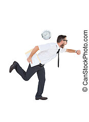 Geeky young businessman running late on white background