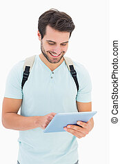 Handsome student using his tablet pc