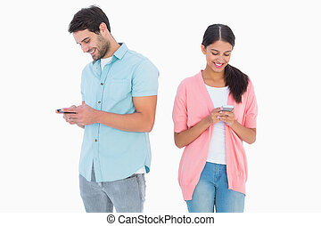 Happy couple sending text messages on white background