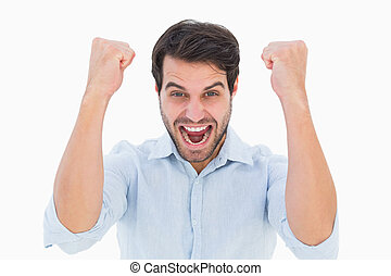 Cheering man looking at camera on white background