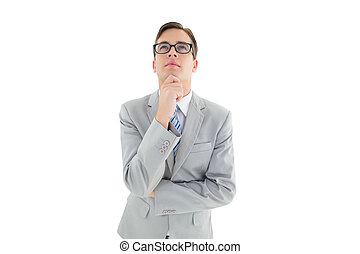 Geeky happy businessman thinking with hand on chin on white...
