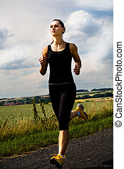 jogging - A woman jogging cross country