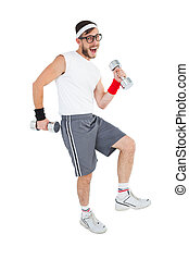 Geeky hipster lifting dumbbells in sportswear on white...