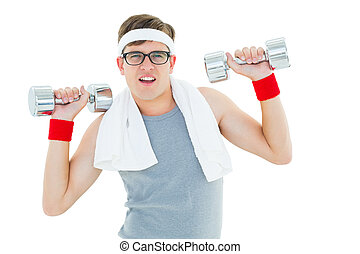 Geeky hipster lifting heavy dumbbells on white background