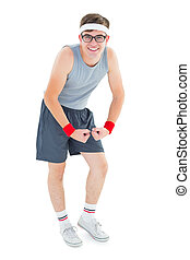 Geeky hipster posing in sportswear on white background