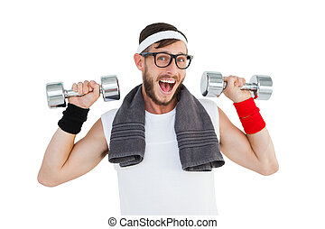 Geeky hipster lifting dumbbells in sportswear