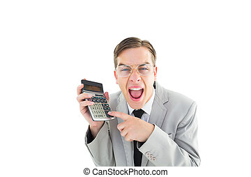 Geeky cheering businessman holding calculator on white...