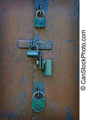 Many locks and bolts on the gate.