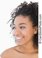 Pretty girl with afro hairstyle smiling on white background