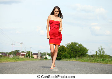Sexy young woman in red dress