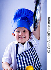 young cook - a 6 years old boy preparing a meal