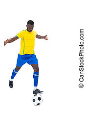 Football player in yellow kicking ball on white background