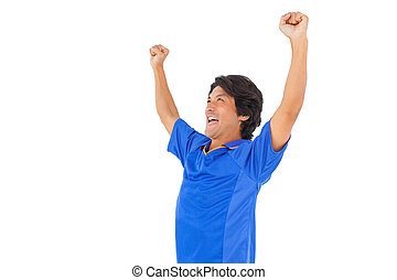 Football player in blue celebrating a victory on white...