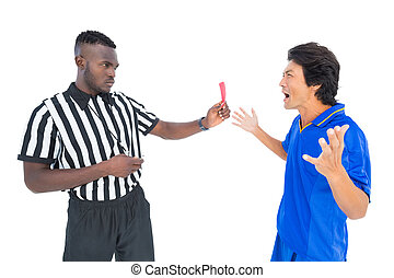 Serious referee showing red card to player on white...