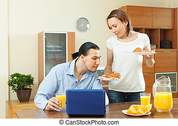 woman serves morning breakfast her beloved man - Smiling...