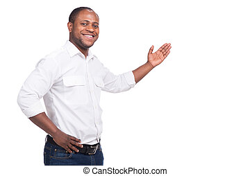 handsome black man standing and smiling. Man raised left...