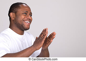 handsome black man clapping hands. attractive male with...