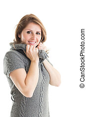 Portrait of woman in warm clothing over white background