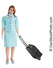 Portrait of stewardess in blue uniform with her bag over...