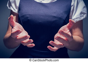 Businesswoman presenting your product with hands - Close up...