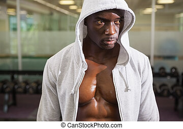 Muscular man in hood jacket