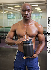 Muscular man with nutritional supplement - Muscular man...