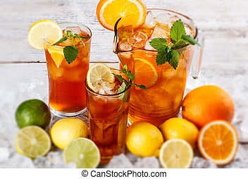 Glass of ice tea with lemon and mint leaf