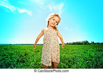 childhood - Pretty little girl on a meadow in summer day....