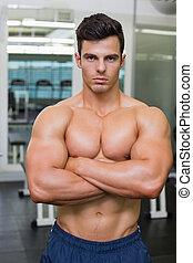 serio, joven, muscular, hombre, gimnasio