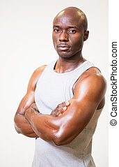 Portrait of a serious muscular man with arms crossed