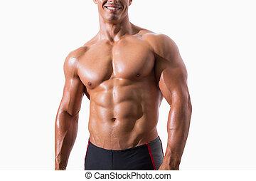 Smiling shirtless muscular man