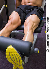 Mid section of muscular man doing a leg workout - Close up...