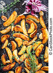 potato wedges - Roasted potato wedges with herbs and garlic...