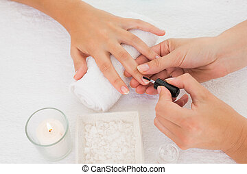 Beautician, applying, nail, varnish, female, client's, nails