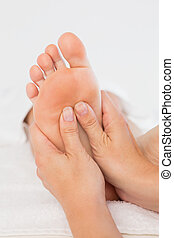 Close-up of a woman receiving foot