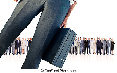 Composite image of businessman holding briefcase against row...