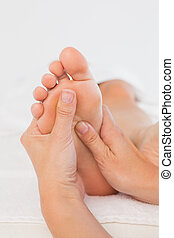 Close-up of a woman receiving foot massage - Close-up of a...