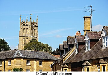 Town buildings, Chipping Campden - St James church seen over...