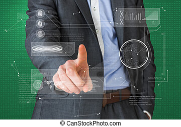 Composite image of businessman in grey suit pointing at interfac