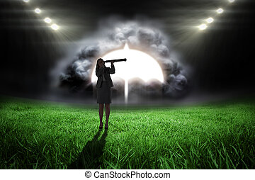Composite image of businesswoman looking through a telescope...