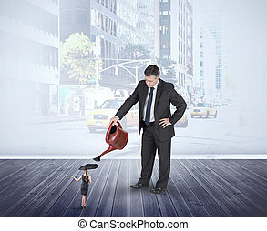 Composite image of mature businessman watering tiny...