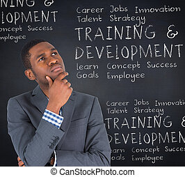 Composite image of young businessman thinking - Young...