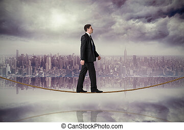 Composite image of handsome businessman stepping on...