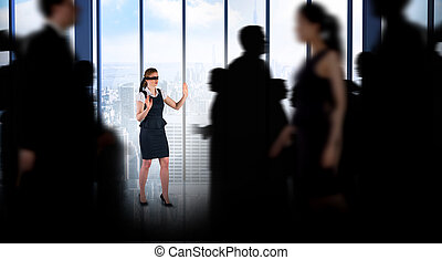 Composite image of business people walking in a blur -...