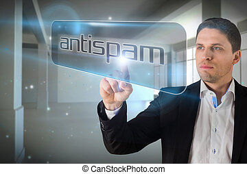 Businessman pointing to word antispam against screen in room...
