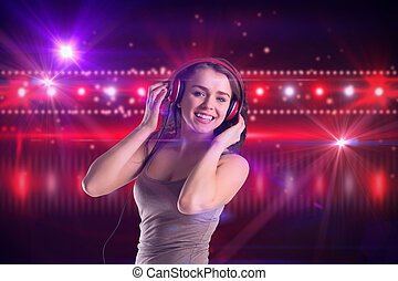 Composite image of pretty girl listening to music - Pretty...