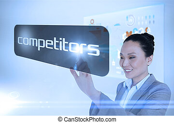 Businesswoman pointing to word competitors against...